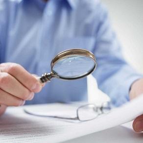 businessman-with-magnifying-glass-reading-PYTZ4L9-_e4724e9975205a0de6c0dc70cd6b45a7